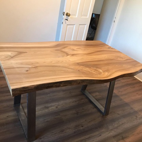 A dining table made from 1 plank of Elm cut in half and put together