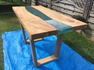 A fantastic river table made from a slab of olive ash we sold